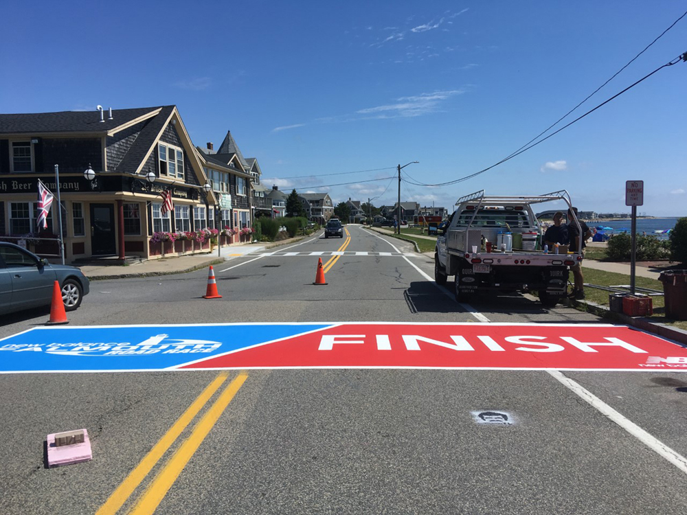 Painting the Falmouth Road Race Finish Line 2019
